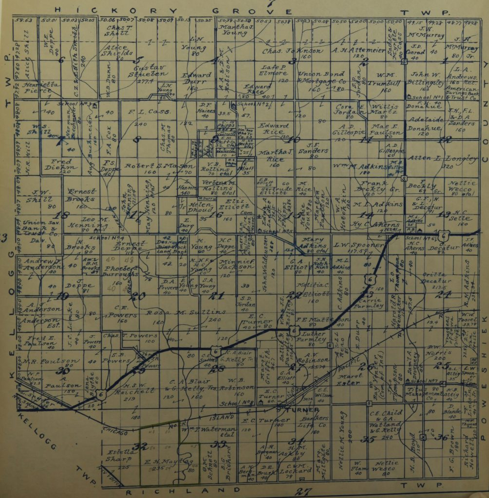 Black pen lines show the streets and blocks of Rock Creek. Land is labelled with the names of land owners. Numbers representing how much land each person owns are written over collections of squares.